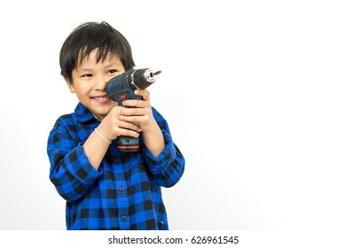 Little boy standing holding a drill over background is white.