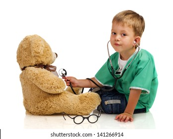 Little boy with stethoscope and teddy bear