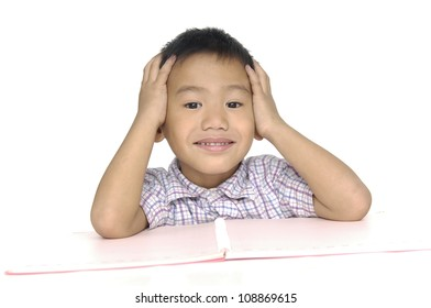 little boy studying with hands near his face isolated