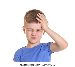 Little boy suffering from headache on white background