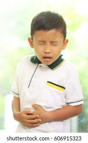 Little boy suffering from stomach pain.