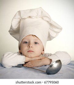 The little boy in a suit of the cook