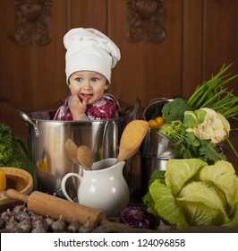 little boy in a suit of the cook in the kitchen preparing soup