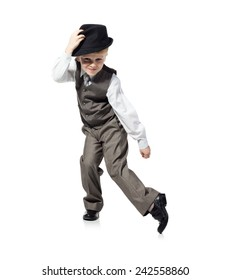 Little boy in suit and hat is dancing, isolated on white. Little boy, who is looked as businessman, is dancing on white background.