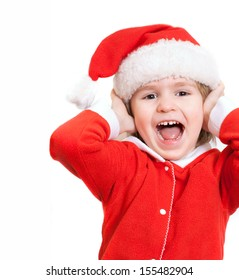 The little boy in a suit of Santa Claus laughs