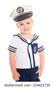 little boy in a suit of the sea cabin boy.On his cap emblem of Russia.