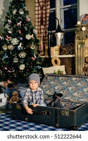 little boy in a suitcase in the Christmas decor, the child in the new year 1