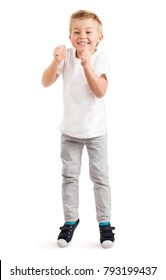 LITTLE BOY SUPPORTING, SMILING HAPPY AND JUMPING BY JOY ISOLATED ON WHITE BACKGROUND, CHEERFUL KID