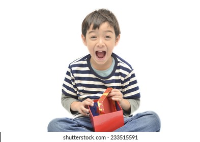 Little boy surprise with gift box on white background