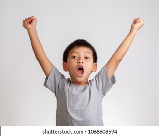 little boy surprised on white background.