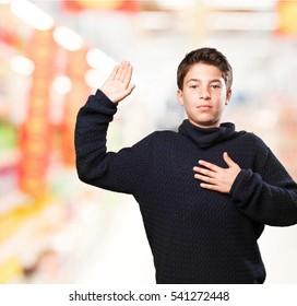 little boy swearing on white
