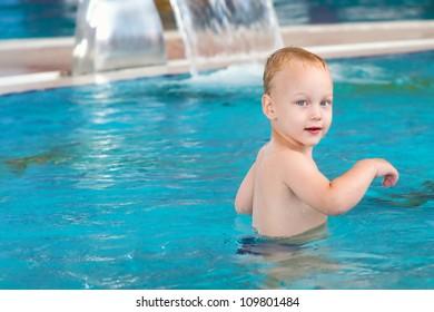Little boy in swimming pool.
