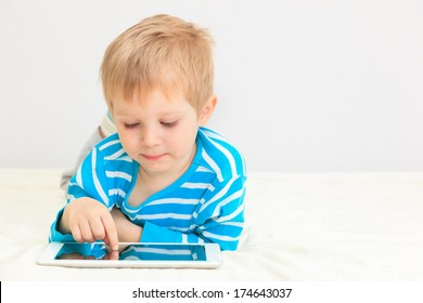 little boy with tablet, early learning