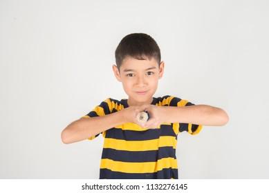 Little boy take a pencil write on the empty white paper
