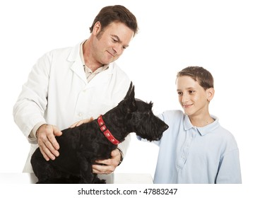 Little boy takes his Scotty dog to the veterinarian.  Isolated on white.