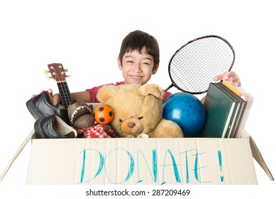 Little boy taking Donation box full with stuff  for donate
