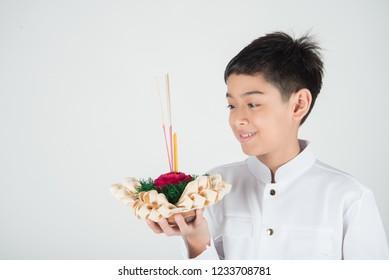 Little boy taking kratong in Loy Kratong floating festival