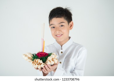 Little boy taking kratong in Loy Kratong floating festival
