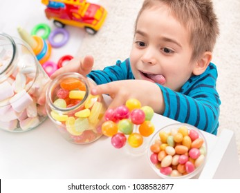 Little boy taking too much candy put aside