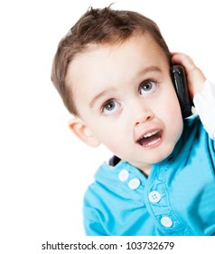 Little boy talking on the phone - isolated over a white background