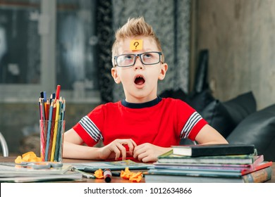 The little boy was thinking, sticking a sticker on his forehead.