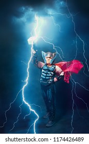 little boy in thor costume with lightnings and thunder epic