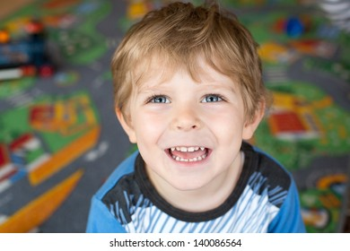Little boy of three years looking at the camera and smiling, indoor