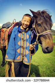 Little Boy Tilting His Head To His Horse And Smiling Concept