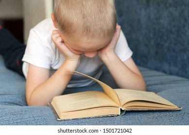 Little boy tired of reading book, school theme