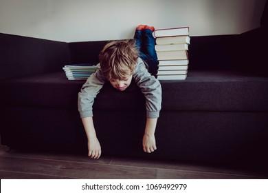 little boy tired stressed of doing homework