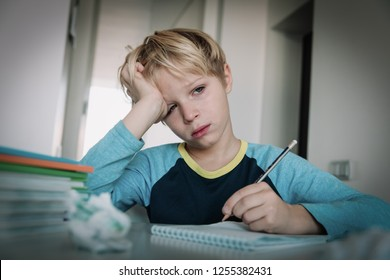 little boy tired stressed of doing homework, bored, exhausted