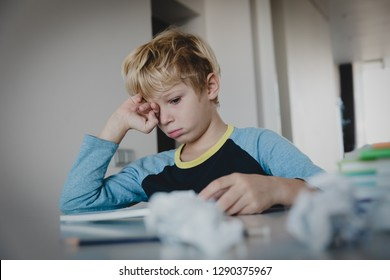 little boy tired stressed of writing, doing homework
