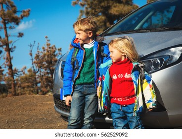 little boy and toddler girl travel by car on the road