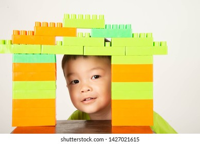 Little boy toddler playing plastic brick block colorful with happy