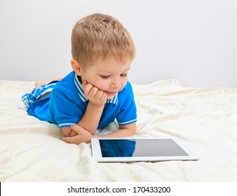 little boy with touch pad, early education and learning