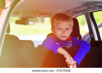 little boy travel by car, family tourism