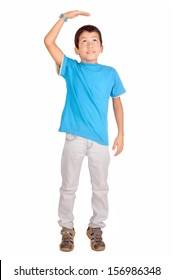 little boy trying to be taller isolated in white