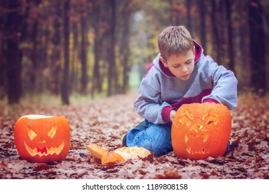 Little boy trying to light his jack o lantern