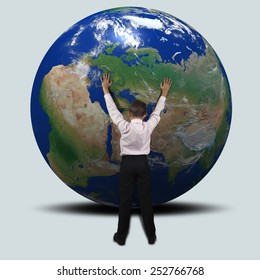 Little boy trying to stop the rolling him Earth. Elements of this image furnished by NASA
