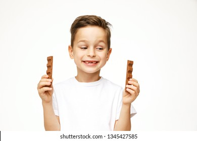 little boy with two chocolates on a white background