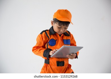 Little boy uniform as a astronout browsing with tablet on white background