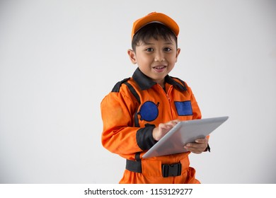Little boy uniform as a astronout look camera with tablet on white background