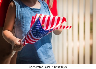 Little boy with USA national flag hand ready for patriotic and american national holiday like 4ht of July, Flag day, national day or memorial day.