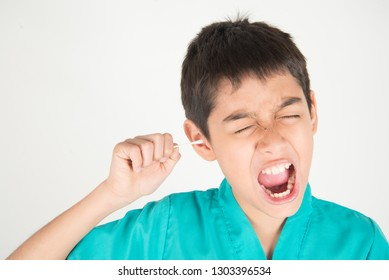 Little boy use cutton bud clean his ears with pain
