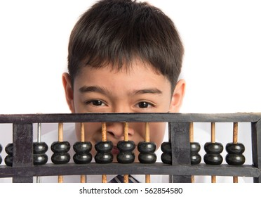 Little boy using abacus to study mathematics education class
