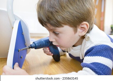 Little Boy using diy tool at home