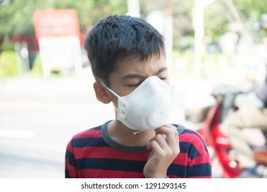 Little boy using Dust Respirator Folding Protection Mask PM2.5 Ear Head Hang