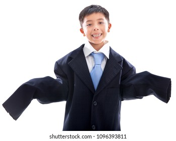 Little boy using his dad's suit. Isolated over white background