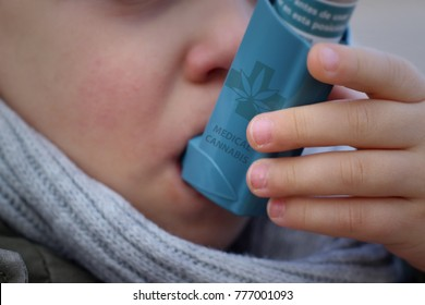 Little boy using a medicinal cannabis inhaler to treat his respiratory problems