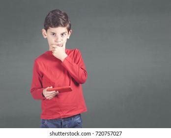 Little boy using a smart phone